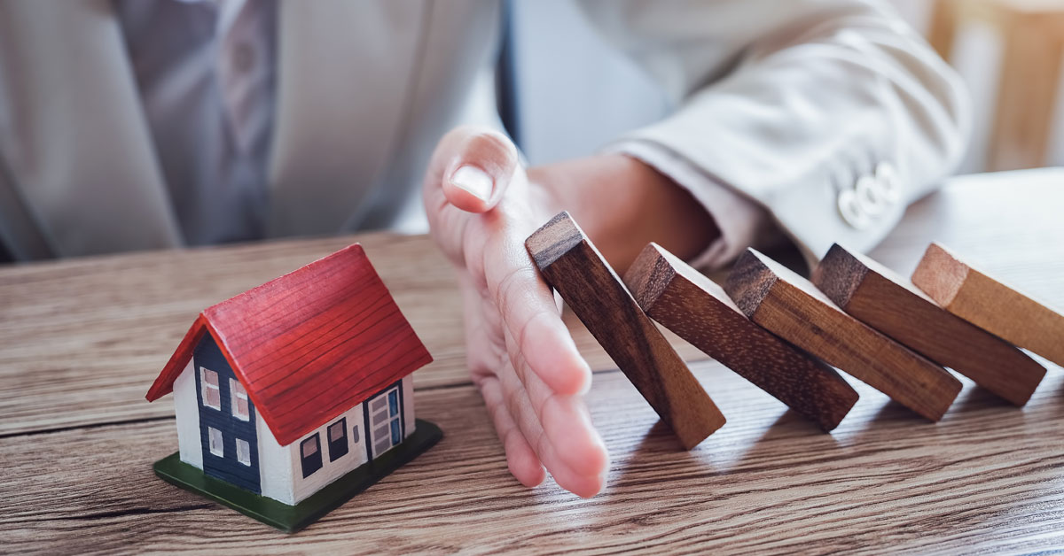 protect-house-from-falling-wooden-blocks-insurance-risk-concept